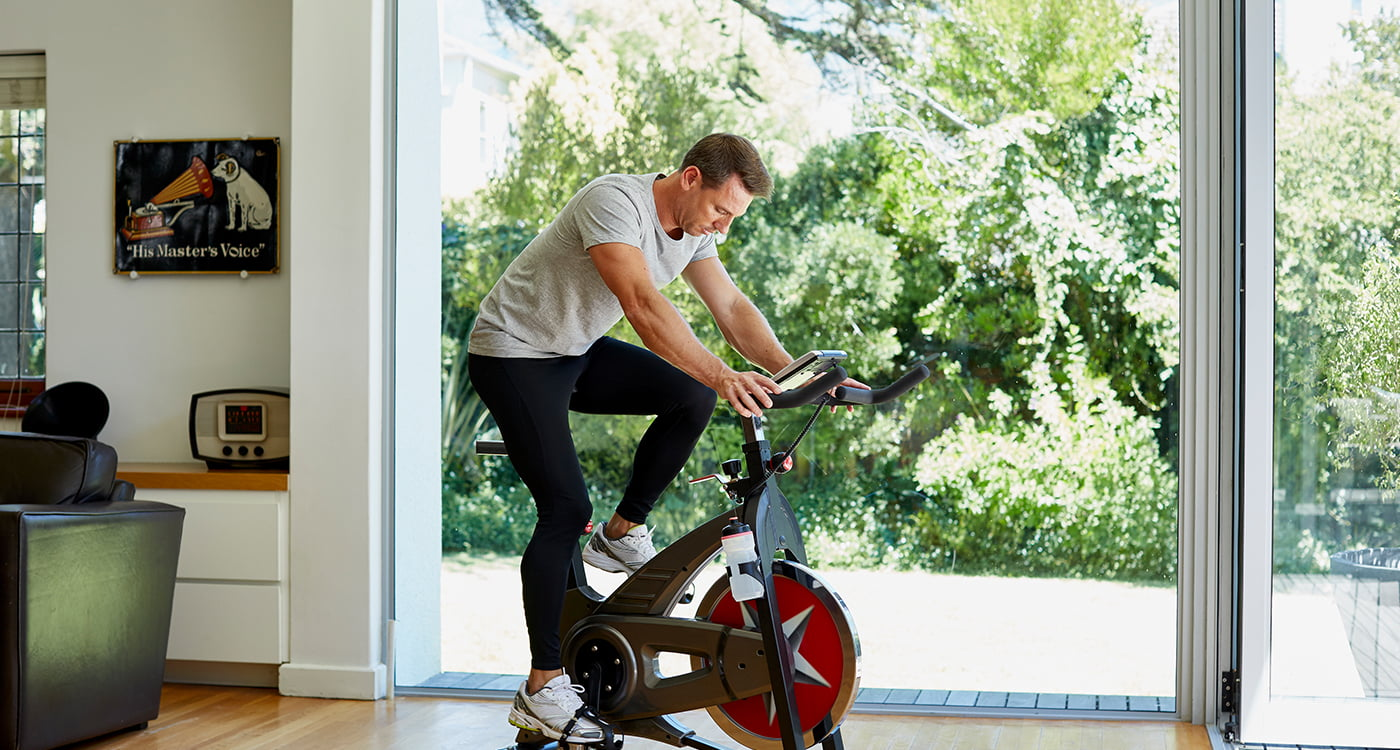 a man exerxising on a machine