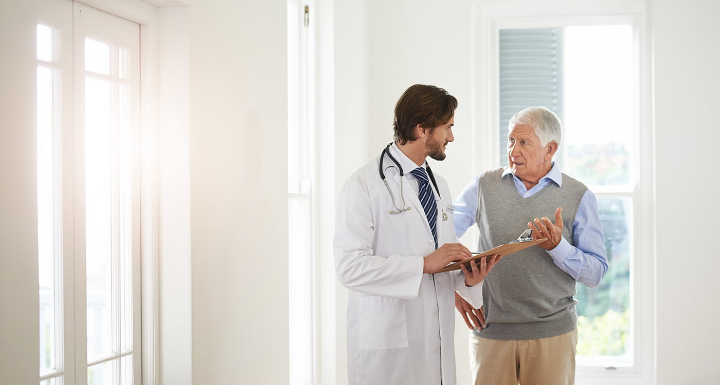 a doctor talking to his patient